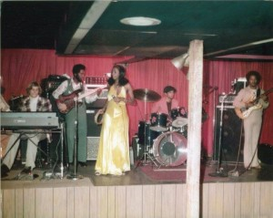 Before she left for Atlanta, Dayton native Dottie Peoples worked in clubs around the Gem City as Lil Dot. Not sure where this gig is at, with that wooden pole up front, but that looks like Mike Manley(aka: Mikael Man) on guitar on the right. Who are the other guys pictured here?